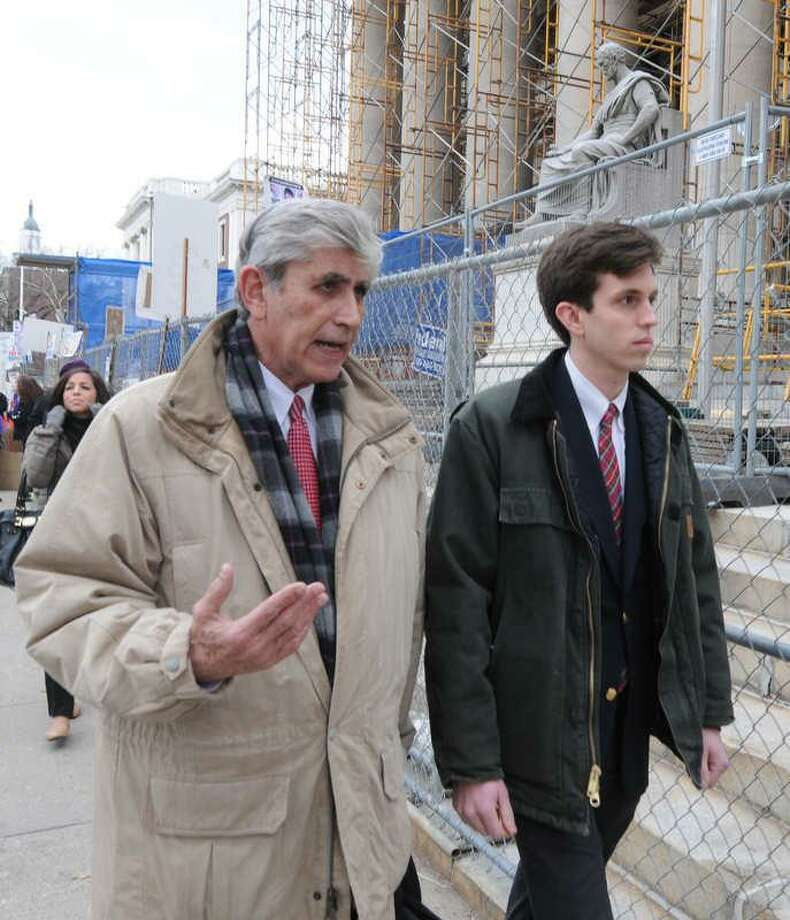 Yale University undergraduate Brendan Ross, right, leaves New Haven Superior Court on Elm Street in New Haven, Conn. with his Lawyer William Dow III Friday, February 1, 2013. after Ross was granted accelerated rehabilitation and given 400 hours of community services in the death of a woman by a U-Haul truck he was driving during a 2011 Yale-Harvard football game. Photo by Peter Hvizdak / New Haven Register Photo: New Haven Register / ©Peter Hvizdak /  New Haven Register