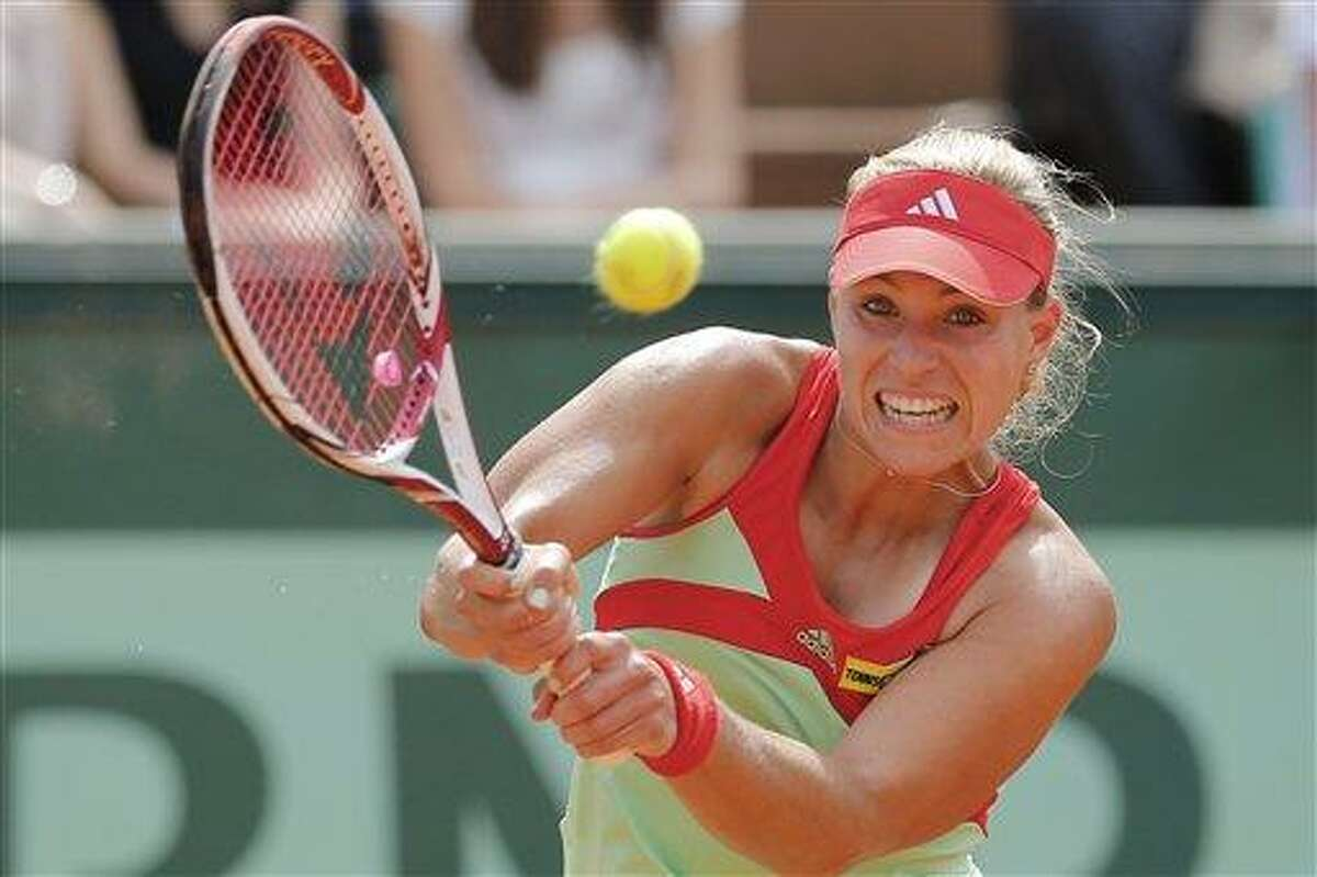 Angelique Kerber of Germany returns in her quarter final match against Sara Errani of Italy at the French Open tennis tournament in Roland Garros stadium in Paris, Tuesday June 5, 2012. Errani won in two sets 6-3, 7-6. (AP Photo/Michel Euler)