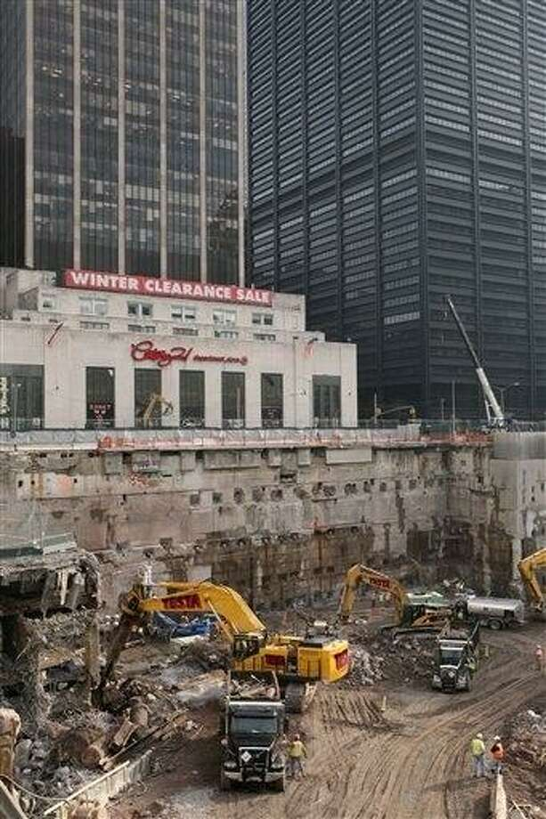 Construction workers and equipment excavate the southeastern corner of the World Trade Center site on in this Jan. 8, 2008 file photo taken in New York. About 60 truckloads of debris that could contain tiny human bone fragments have been unearthed by construction crews working on the new World Trade Center tower in recent years. That material is now being transported to a park built on top of the former Fresh Kills landfill on Staten Island. City officials say investigators will spend 10 weeks attempting to identify the remains. Investigators began sifting through newly uncovered debris from the World Trade Center on Monday April 1, 2013 for the first time in three years. AP Photo/Mark Lennihan Photo: AP / ap