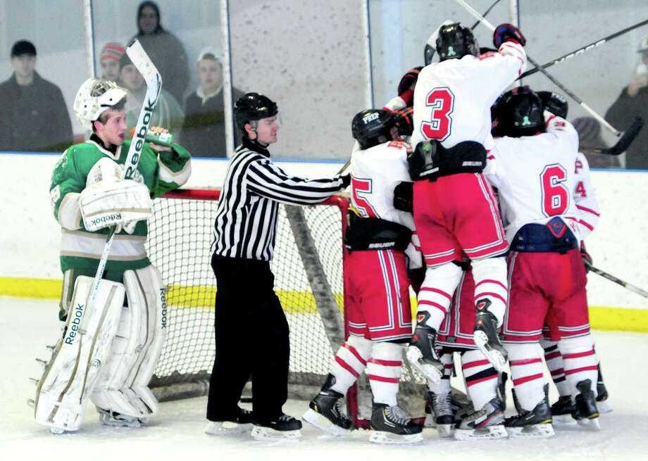 Notre Dame of West Haven goalie Luciano Amatruda, left, watches Fairfield Prep celebrates a score in the final seconds of the second period in Bridgeport last month. Photo by Arnold Gold/New Haven Register