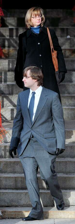 Susanne Kos (top) and her son, James (bottom), leave Superior Court in New Haven on 2/1/2013.Photo by Arnold Gold/New Haven Register   AG0482D