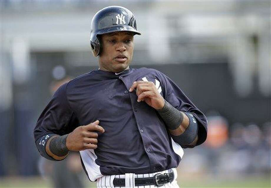 New York Yankees' Robinson Cano runs to third base during a MLB spring training baseball game against the Philadelphia Phillies Friday, March 1, 2013, in Tampa, Fla. (AP Photo/Chris O'Meara) Photo: AP / AP