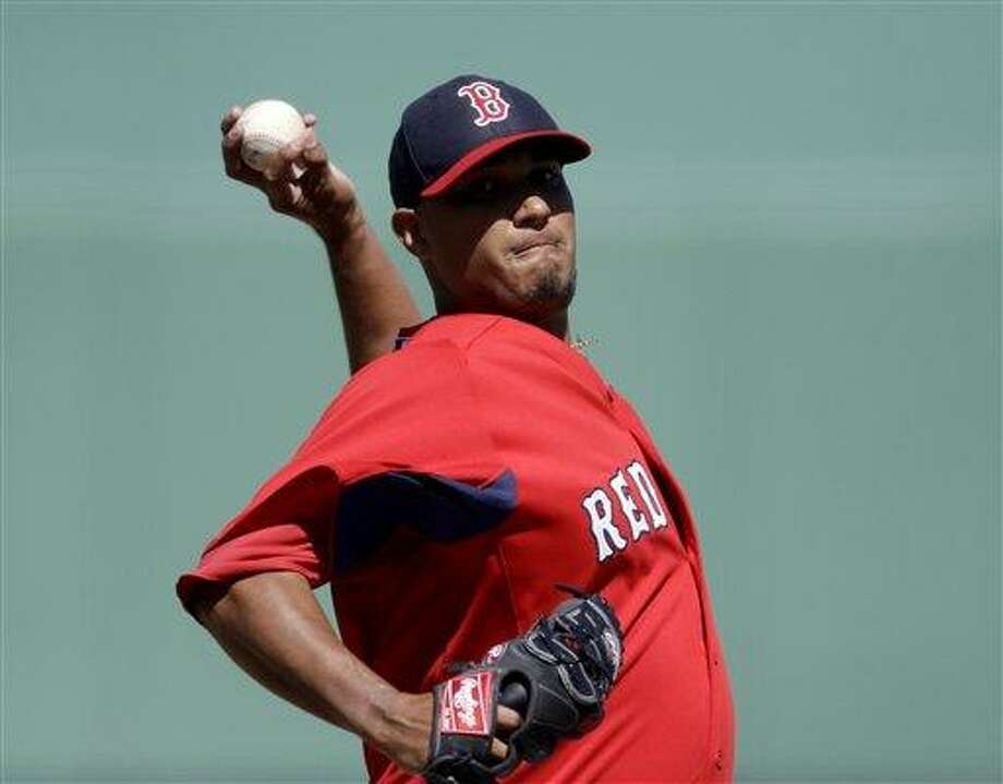 Boston Red Sox starting pitcher Felix Doubront throws in the first inning of an exhibition spring training baseball game against the Tampa Bay Rays, Monday, March 4, 2013, in Fort Myers, Fla. (AP Photo/David Goldman) Photo: AP / AP