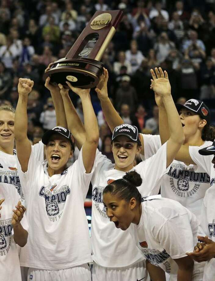 Connecticut celebrates after beating Kentucky in the women's NCAA East  regional final basketball game against in Bridgeport, Conn., Monday, April 1, 2013. Connecticut won 83-53 and advances to the Final Four. (AP Photo/Charles Krupa) Photo: AP / AP2013