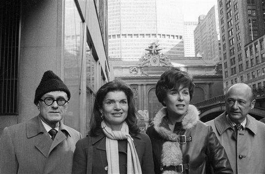 "FILE - In this Jan. 30, 1975, file photo, Jacqueline Kennedy Onassis, center left, and Bess Myerson, center right, walk with architect Philip Johnson, left, and Rep. Ed Koch, right, as they leave New York's Grand Central after holding a news conference for the ""Committee to Save Grand Central Station."" Koch, the combative politician who rescued the city from near-financial ruin during three City Hall terms, has died at age 88. Spokesman George Arzt says Koch died Friday morning Feb. 1, 2013 of congestive heart failure. (AP Photo/Harry Harris, File) Photo: AP / AP"