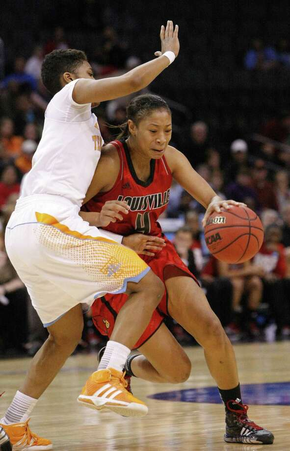 Tennessee's Kamiko Williams, left, defends as Louisville's guard Antonita Slaughter (4) drives to the basket during the first half of the regional final in the NCAA women's college basketball tournament in Oklahoma City, Tuesday, April 2, 2013.   (AP Photo/Alonzo Adams) Photo: AP / FR159426 AP
