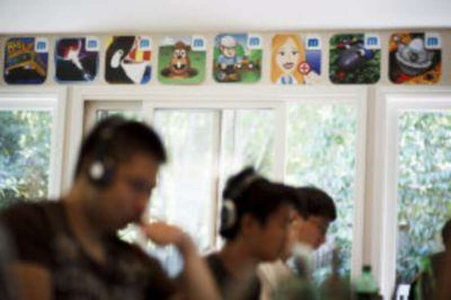 """Icons of some of mobile games that have been published or worked on at <a href=""""http://MakeGamesWith.Us"""">MakeGamesWith.Us</a> are displayed at the office of <a href=""""http://MakeGamesWith.Us"""">MakeGamesWith.Us</a> in Palo Alto on Aug. 14, 2013. The <a href=""""http://MakeGamesWith.Us"""">MakeGamesWith.Us</a> internship is a four to nine week program. Each intern must participate for a minimum of four weeks and can participate for nine weeks. The goal is to develop a mobile game worthy of the app store. (Dai Sugano/Bay Area News Group) Photo: Dai Sugano/Bay Area News Group / Dai Sugano/Bay Area News Group"""