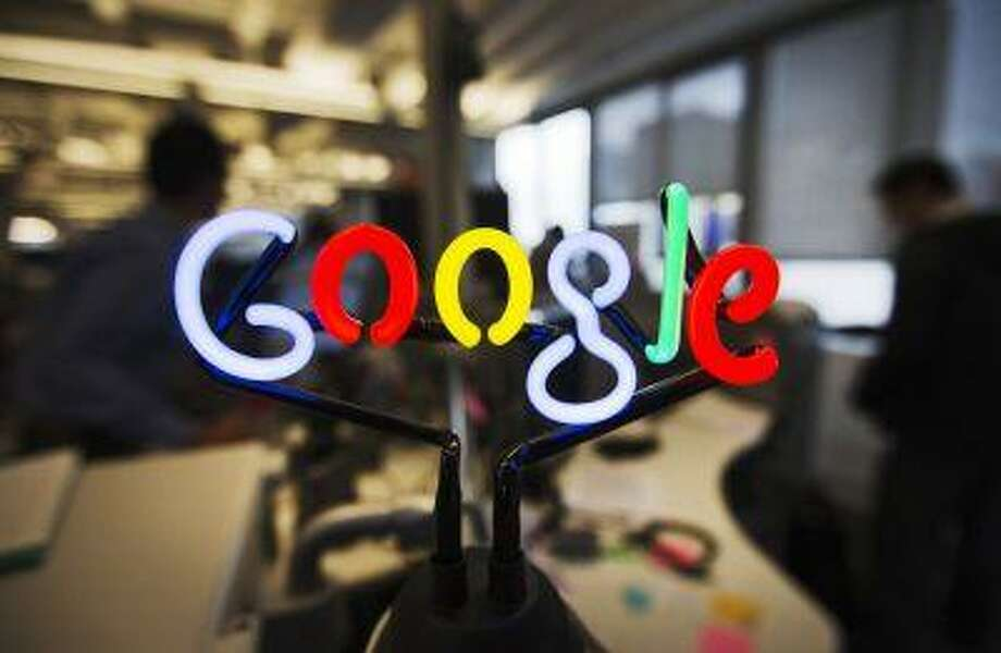 A neon Google logo is seen at the new Google office in Toronto, November 13, 2012. REUTERS/Mark Blinch (CANADA - Tags: SCIENCE TECHNOLOGY BUSINESS LOGO) - RTR3ACWW Photo: REUTERS / X02025