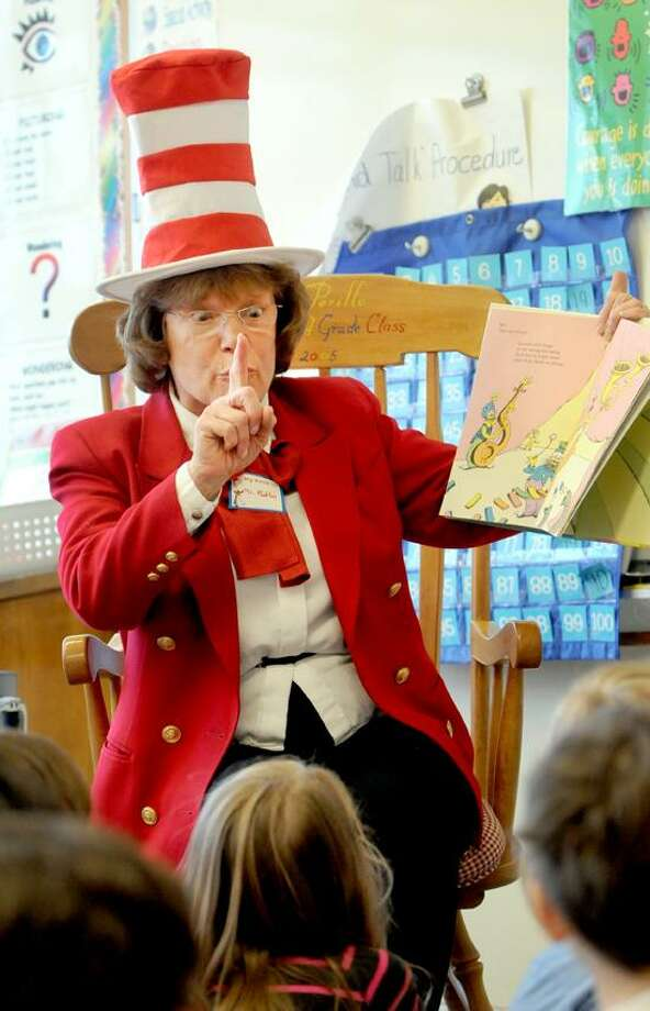Anita Rutlin, Assistant Superintendent of Madison Schools, reads to Island Avenue School second graders Friday, March, 1, 2013 during a celebration of Read Across American Day at Island Ave. School in Madison, Connecticut. Photo by Peter Hvizdak / New Haven Register Photo: New Haven Register / ©Peter Hvizdak /  New Haven Register