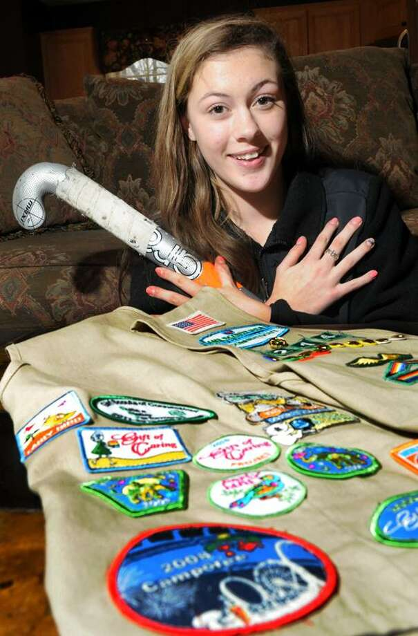 Alex Becker, 16, of Guilford,  with her Girl Scout vest that shows off her accomplishments, is receiving the highest Girl Scout award for a program she created to help girls at St. Martin de Porres school in New Haven learn to play field hockey. Wednesday, February 27, 2013. Photo by Peter Hvizdak / New Haven Register Photo: New Haven Register / ©Peter Hvizdak /  New Haven Register