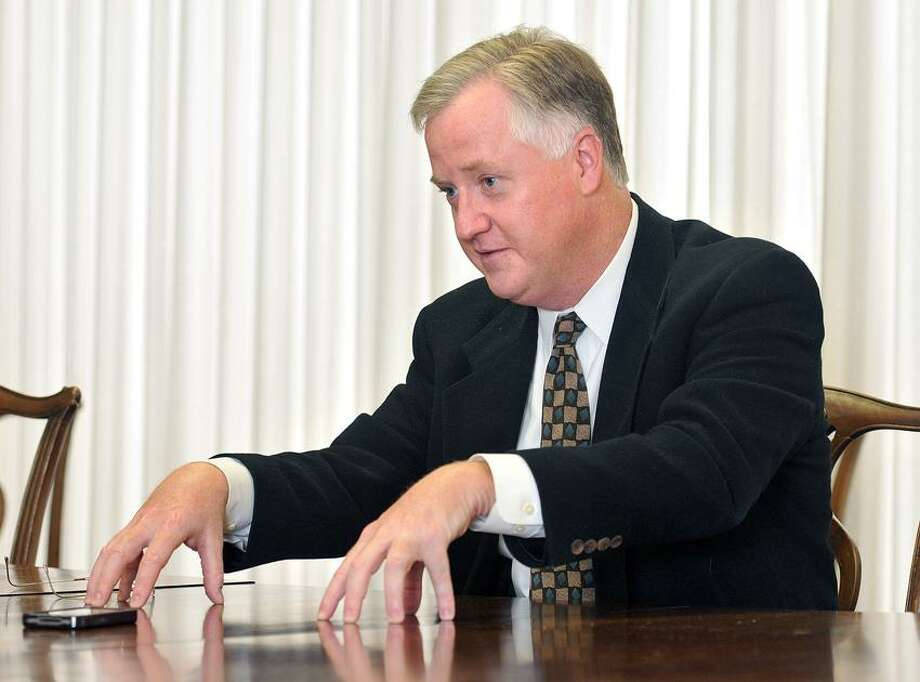 New Haven--House speaker Brendan Sharkey speaks with Register reporter Mary O'Leary about the state budget and the sequester during an interview in the Editorial Conference room at the newspaper. Photo-Peter Casolino 03/01/12