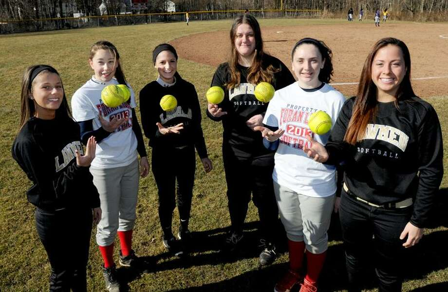 The 2012-13 Foran and Law softball captains, from left to right: Shea Laguonigro of Law; Rebekah DeRosa of Foran; Stephanie Peloso of Law; Jillian Theil of Law; Gina Georgetti of Foran; and Sam Murphy of Law. Photo by Peter Hvizdak / New Haven Register. Photo: New Haven Register / ©Peter Hvizdak /  New Haven Register