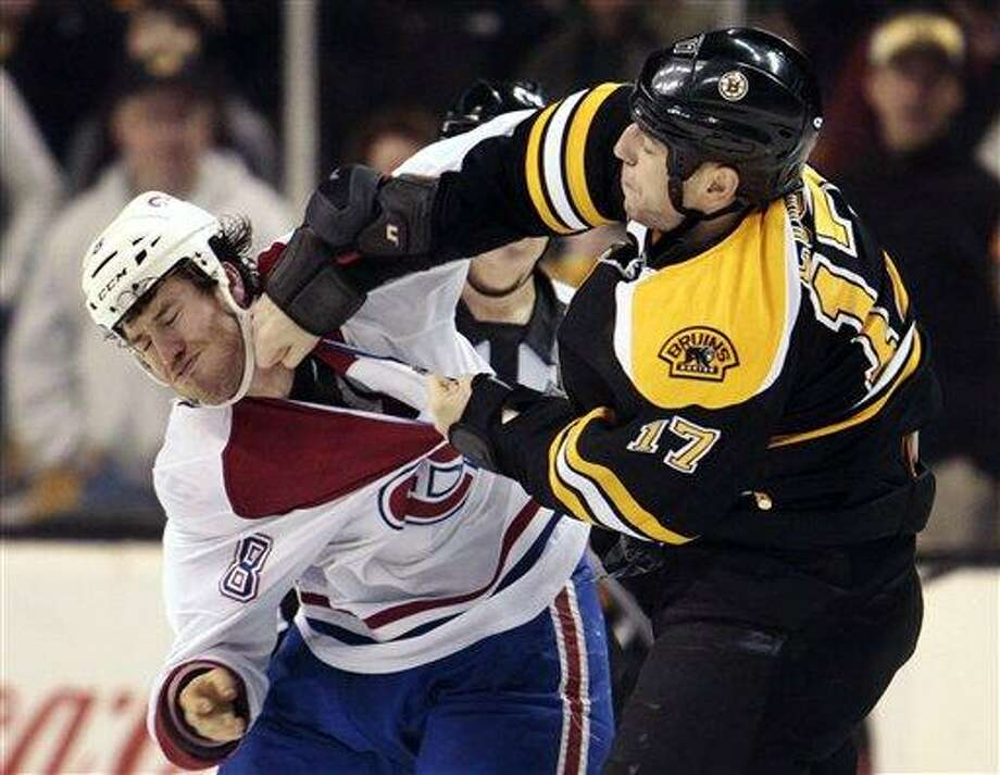 Montreal Canadiens right wing Brandon Prust (8) exchanges blows with Boston Bruins left wing Milan Lucic (17) in the second period of an NHL hockey game in Boston, Sunday, March 3, 2013. (AP Photo/Steven Senne) Photo: AP / AP