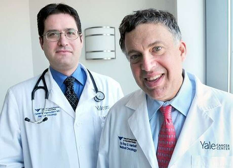 Dr. Daniel Morgensztern (left), assistant professor of Medical Oncology, and Dr. Roy Herbst, Chief of Medical Oncology, are photographed at Smilow Cancer Hospital at Yale-New Haven in New Haven on 2/28/2013.Photo by Arnold Gold/New Haven Register   AG0485C