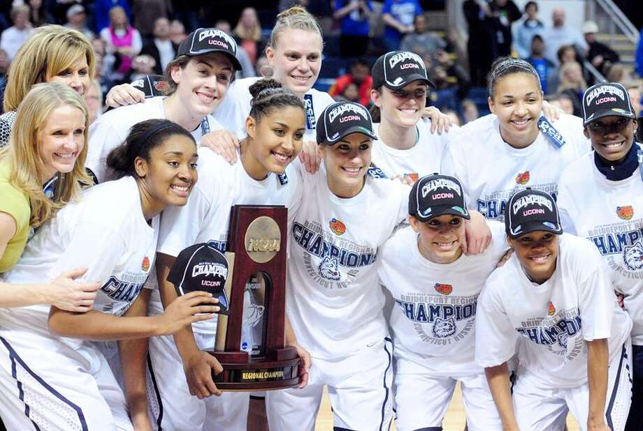 UCONN women celebrate after defeating the University of Kentucky to win the NCAA Regional Championship in Bridgeport on 4/1/2013.Photo by Arnold Gold/New Haven Register