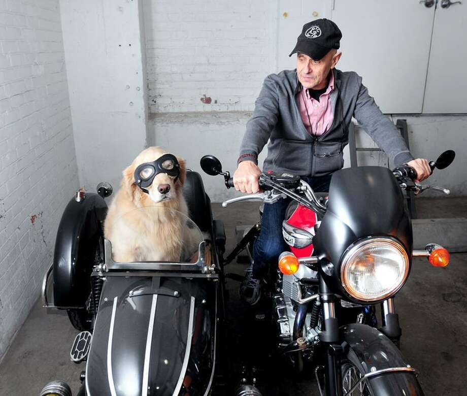 Danny Klein is photographed with his therapy dog, Remy, in a sidecar in the garage of their apartment building in New Haven on 2/14/2013.Photo  by Arnold Gold/New Haven Register   AG0483B