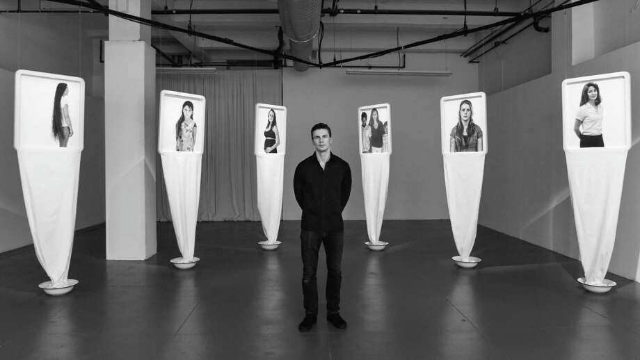 "Artist Branislav Jankic of Serbia stands in front of his art exhibit, ""Letter To My Mother"" at Spring Studio Gallery in New York, June 2016. Jankic also directed a movie based on the exhibit featuring 40 mothers who suffered with addictions and their children, including 16 women from San Antonio's Alpha Home. Photo: Courtesy / Branislav Jankic, Photographer / Zach Hilty/BFA.com / BFA"