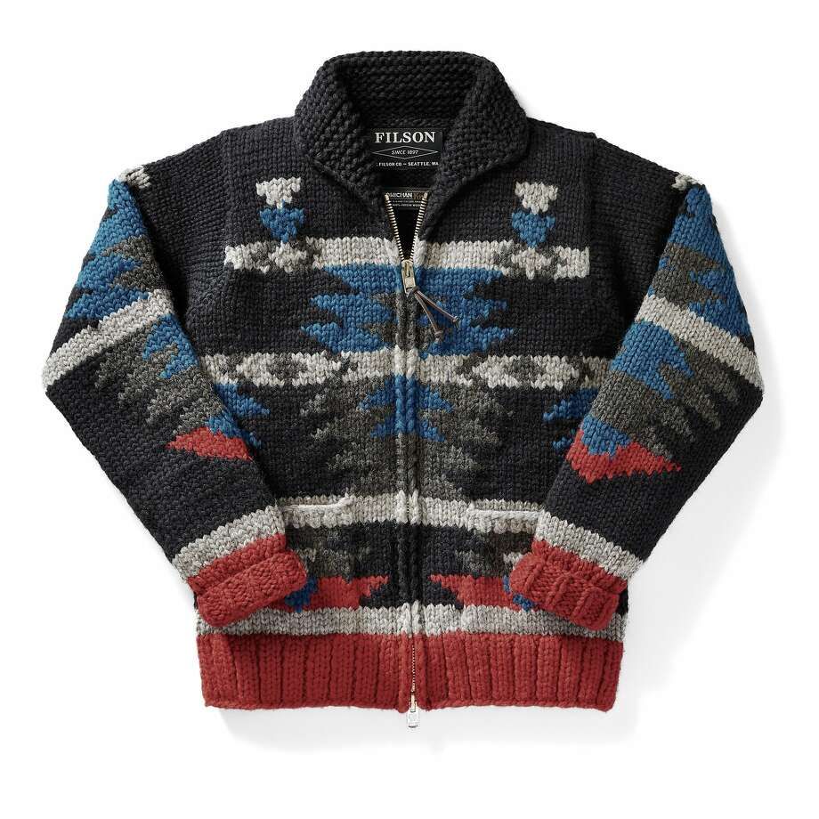 The cardigan:   Cowichan knitting is characteristic of the First Nations Cowichan Tribe of Vancouver Island, B.C. It originated when early European settlers brought their knitting and wool harvesting techniques to the Cowichan tribes. Each holiday season, Filson creates original designs and commissions traditional Cowichan sewers to create limited-edition (175) seasonal Cowichan sweaters (such as the Cascadia) scarves, and hats each made using traditional heavy-weight, hand-spun wool. Photo: Filson