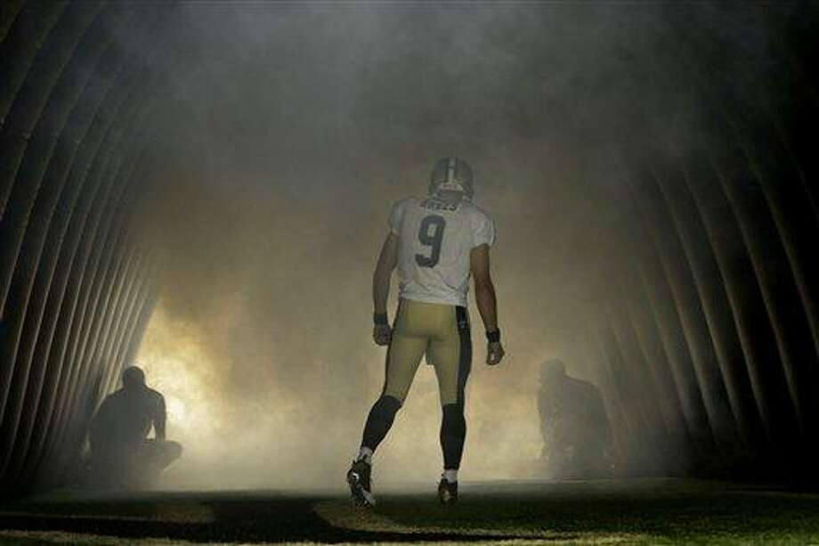 New Orleans Saints quarterback Drew Brees (9) waits to run on the field before an NFL preseason football game against the Oakland Raiders at the Mercedes-Benz Superdome in New Orleans, Friday, Aug. 16, 2013. (AP Photo/Gerald Herbert) Photo: AP / AP