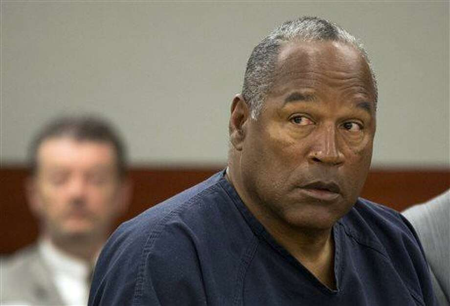 FILE - In this May 16, 2013 file photo, O.J. Simpson listens during an evidentiary hearing in Clark County District Court, Thursday, May 16, 2013 in Las Vegas.  O.J. Simpson won a small victory Wednesday. July 31, 2013, in his bid for freedom as Nevada granted him parole on some of his convictions in a 2008 kidnapping and armed robbery involving the holdup of two sports memorabilia dealers at a Las Vegas hotel room. (AP Photo/Julie Jacobson, Pool, File) Photo: AP / Pool AP