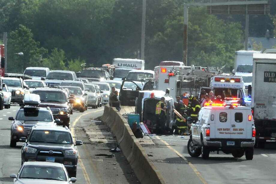 Traffic in the south bound lane of I95 was snarled at rush hour when a vechile  overturned in the left hand requirinf the attention of emergency responderes. Vern Williams/New Haven Register 07.31.13