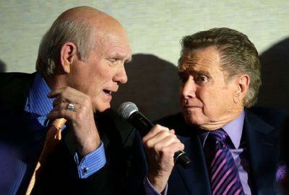 Regis Philbin, right, jokes with Terry Bradshaw during a news conference about Fox's new sports network in New York, Tuesday, March 5, 2013. Philbin will host a weekday sports talk show for the network's new channel Fox Sports 1.