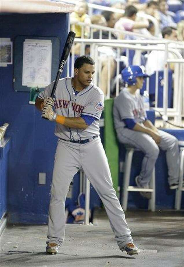 New York Mets center fielder Juan Lagares swings a bat in the dugout during the fourth inning of a baseball game against the Miami Marlins, Wednesday, July 31, 2013 in Miami. (AP Photo/Wilfredo Lee) Photo: AP / AP