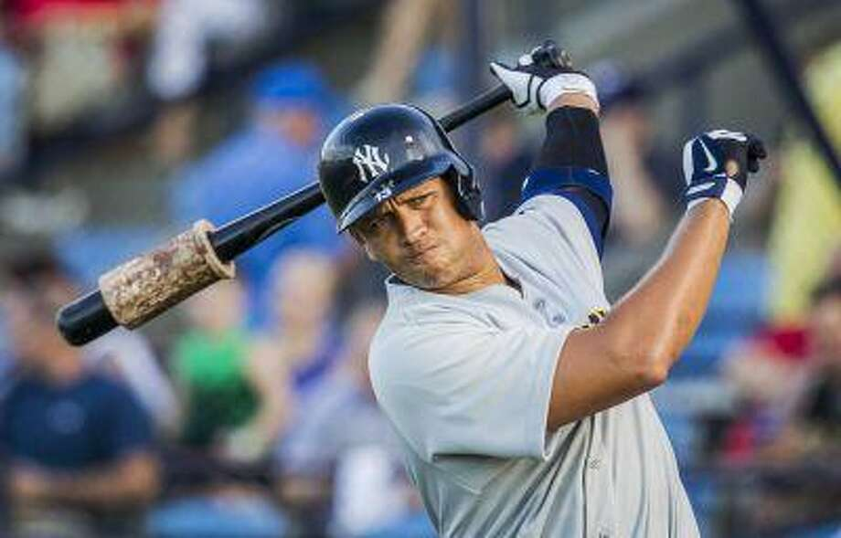 In this Monday, July 15, 2013, photo, New York Yankees third baseman Alex Rodriguez warms up before batting against the Reading Fightin Phils, during his rehab appearance with the Trenton Thunder in Reading, Pa. Photo: AP / PennLive.com