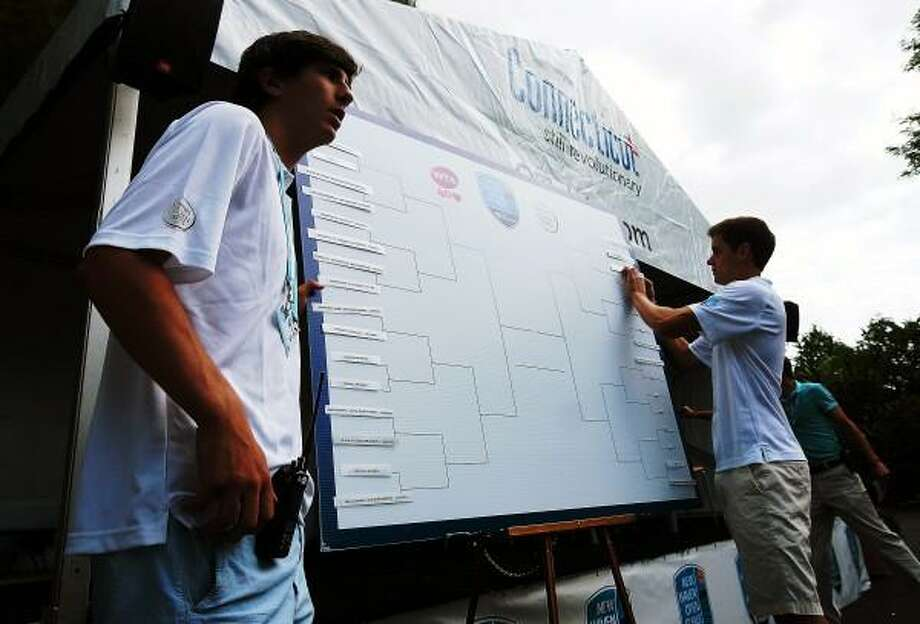 "Peter Casolino â?? RegisterJake Hirschberg, left, and Nick Laub place the names on the board during the Draw ceremony at the New Haven Open at Yale.<a href=""mailto:pcasolino@newhavenregister.com"">pcasolino@newhavenregister.com</a>"