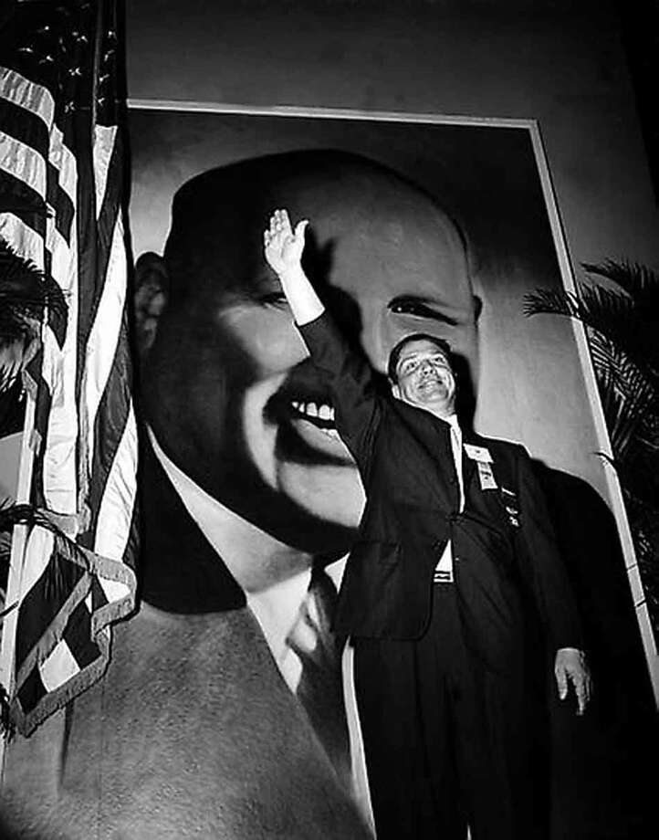 Jimmy Hoffa, Teamsters vice president and leading candidate to succed Dave Beck as the IBT's new president, waves to delegates at the opening of the Teamsters Union convention at Miami Beach, Fla., September 30, 1957. (AP Photo) Photo: ASSOCIATED PRESS / AP1957