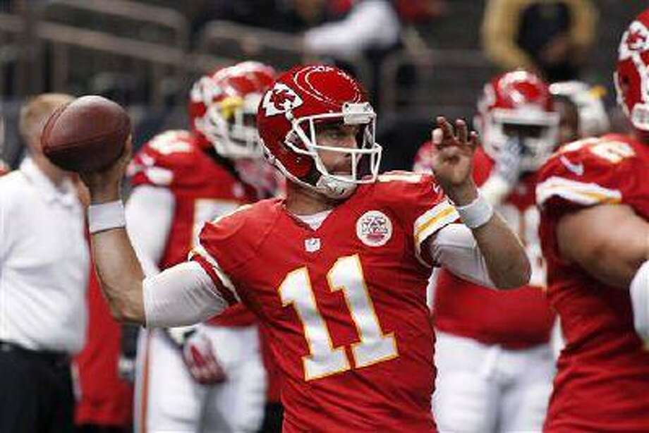 Kansas City Chiefs quarterback Alex Smith warms up before a preseason game at the Mercedes-Benz Superdome in New Orleans, Friday, Aug. 9, 2013. Photo: AP / FR170615 AP
