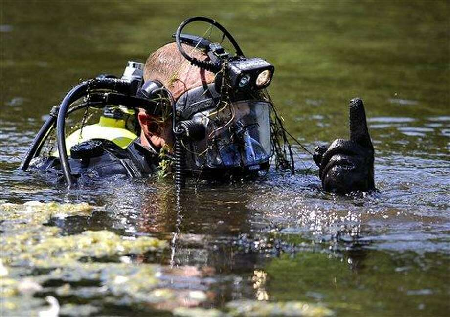 Connecticut State Police Dive Team continue to search for the second day, Pine Lake in Bristol, Conn., the hometown of the former New England Patriots player Aaron Hernandez,  Tuesday, July 30, 2013. Authorities have declined to comment on the search except to confirm it is related to the Hernandez investigation.  Hernandez has pleaded not guilty to murder in the death of Odin Lloyd, a 27-year-old Boston semi-professional football player. (AP Photo/Jessica Hill) Photo: AP / FR125654 AP