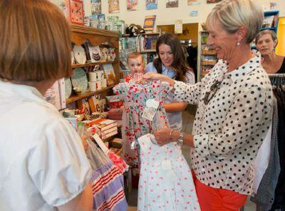 From right, Cecelia Warner, Katy Christiansen, Sara Jayne Baldwin and Caroline Baldwin shopping with some help from Diane Etherington (left) at The Children's Hour in Salt Lake City Tuesday July 23, 2013. (The Salt Lake Tribune/Trent Nelson)