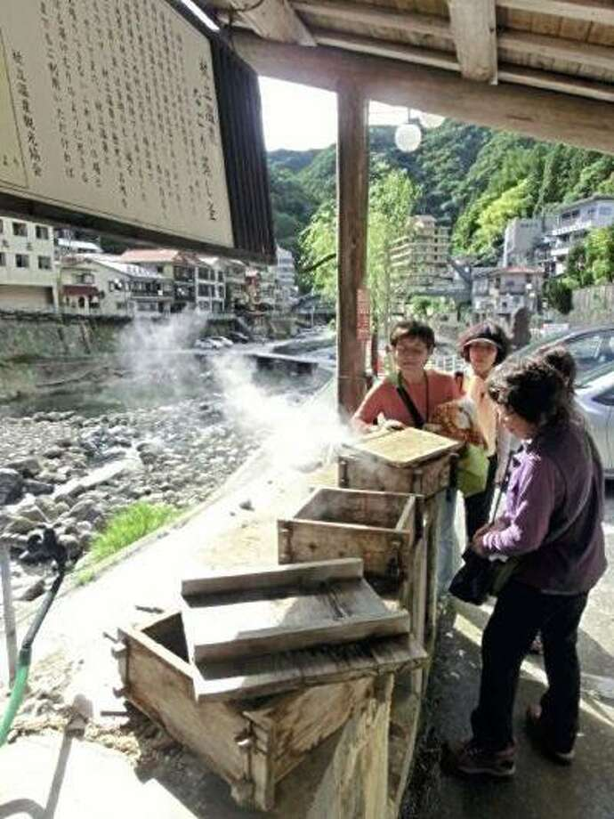 Locals gather to steam vegetables and eggs at the Tsuetate Onsen hot spring. (Yomiuri Shimbun photo) Photo: THE WASHINGTON POST / THE WASHINGTON POST