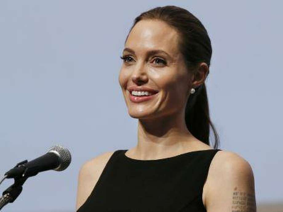 """Angelina Jolie delivers a statement before screening the film """"In the Land of Blood and Honey"""" directed by her, at the United Nations University in Tokyo Monday, July 29, 2013. (AP Photo/Koji Sasahara) Photo: ASSOCIATED PRESS / AP2013"""