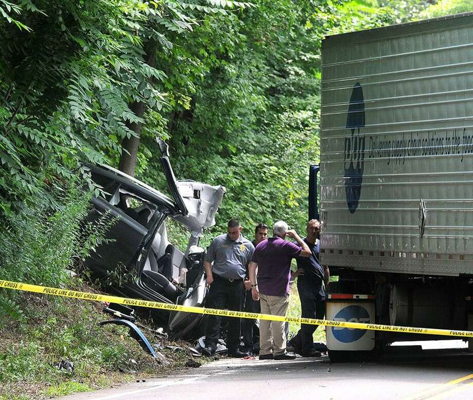 Investigators and police at the scene of a fatal crash between an 18-wheeler truck and a vehicle along Route 34 in Derby near Lakeview Terrace Monday. Peter Casolino/Register