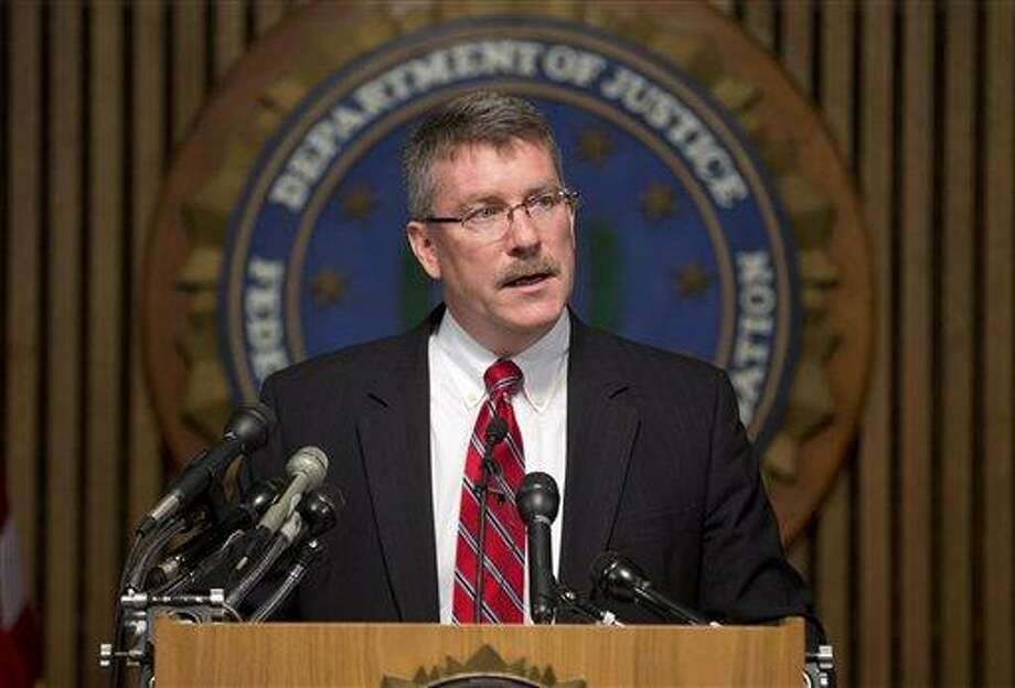 """Ron Hosko, assistant director of the FBI's Criminal Investigative Division, speaks during a news conference at FBI headquarters in Washington, Monday, July 29, 2013, about """"Operation Cross Country."""" The FBI says the operation rescued 105 children who were forced into prostitution in the US and arrested 150 people it described as pimps and others in a series of raids in 76 American cities. (AP Photo/Evan Vucci) Photo: AP / AP"""