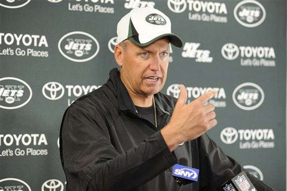 New York Jets coach Rex Ryan speaks to the media at their NFL football training camp Monday, July 29, 2013, in Cortland, N.Y. (AP Photo/Bill Kostroun) Photo: AP / FR51951 AP