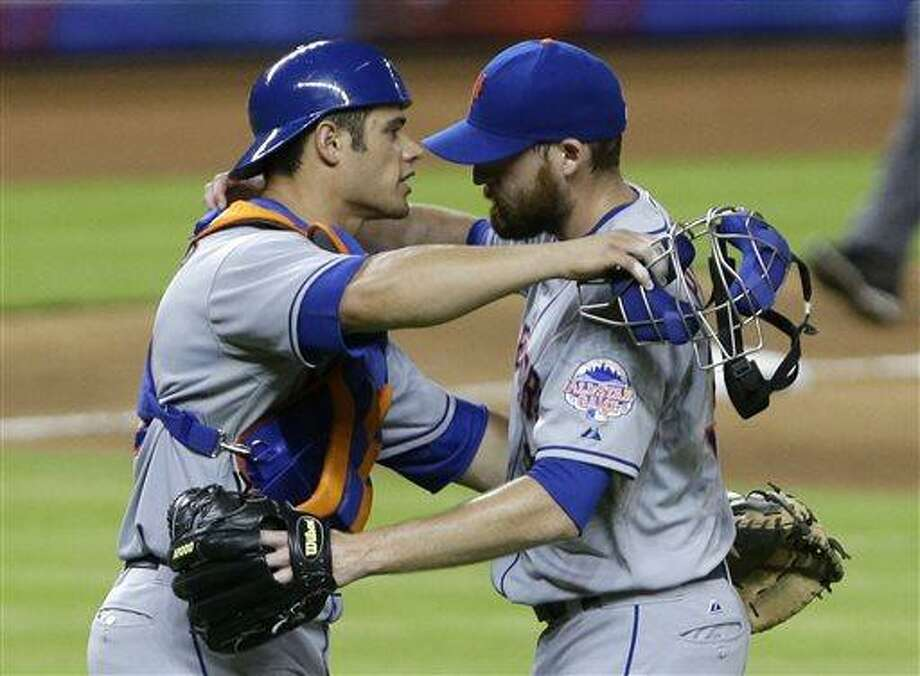 New York Mets relief pitcher Bobby Parnell, right, and catcher Anthony Recker hug after the Mets defeated the Miami Marlins 6-5 in a baseball game, Monday, July 29, 2013 in Miami. (AP Photo/Wilfredo Lee) Photo: AP / AP