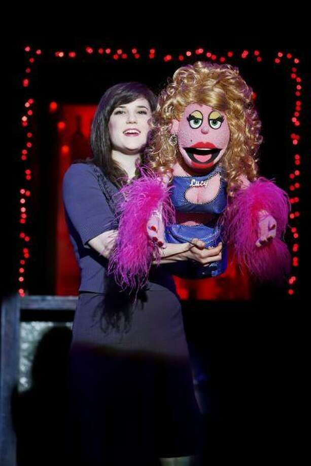 """This May 23, 2013 photo released by Sam Rudy Media Relations shows Veronica Kuehn with Lucy in a scene from """"Avenue Q,"""" in New York. This summer, """"Avenue Q,"""" which began life in an off-Broadway theater downtown, had a six-year Broadway run at the Golden Theatre and is now off-Broadway again, is celebrating the 10th anniversary of its arrival on Broadway. (AP Photo/Sam Rudy Media Relations, Carol Rosegg) Photo: AP / Sam Rudy Media Relations"""