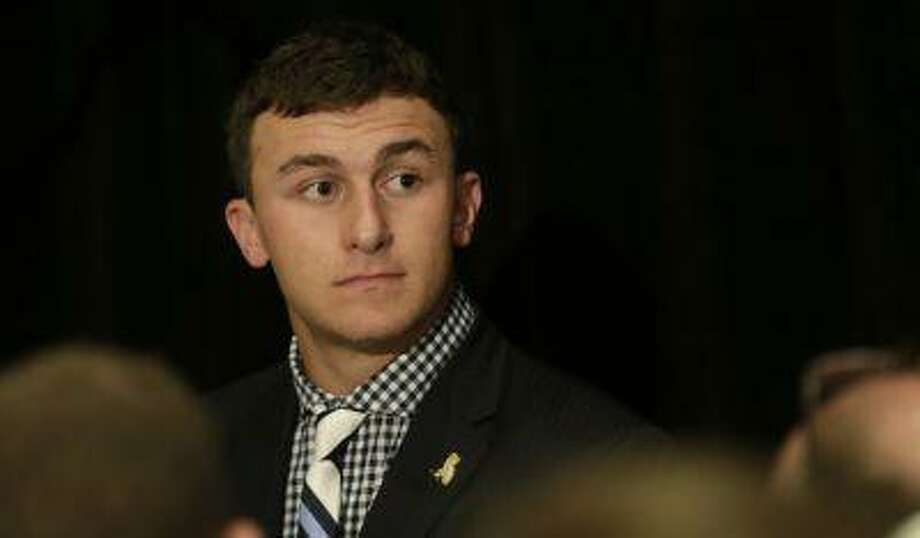 Texas A&M quarterback Johnny Manziel talks with reporters during the Southeastern Conference football Media Days in Hoover, Ala., Wednesday, July 17, 2013. Photo: ASSOCIATED PRESS / AP2013