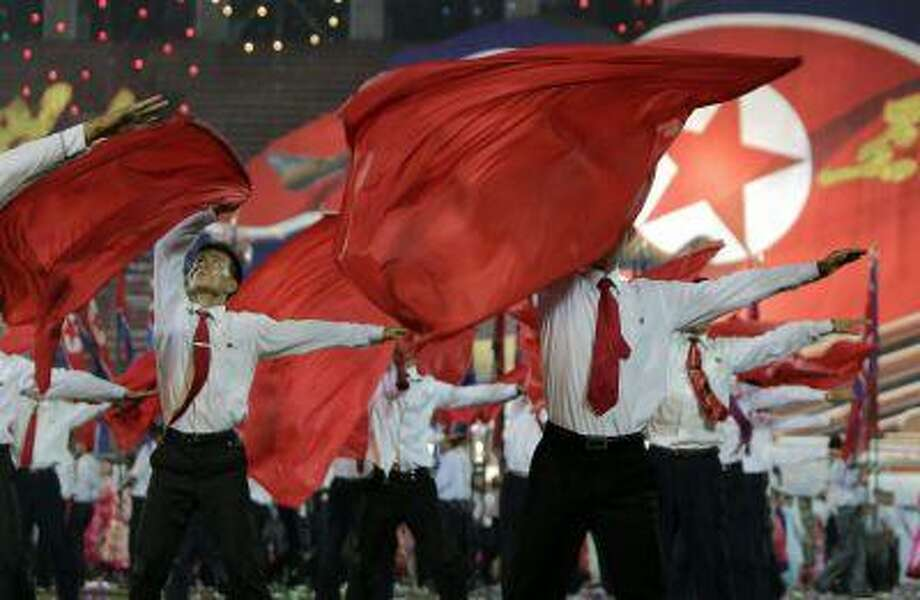 North Korean men perform during a celebration event to commemorate the 60th anniversary of the signing of a truce in the 1950-1953 Korean War, at Kim Il-sung Stadium in Pyongyang July 28, 2013. Photo: REUTERS / X01757