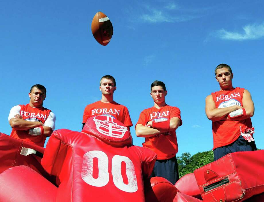 Photo by Peter Hvizdak -- New Haven Register Foran High School football players from left: Wide receiver Nick Weissauer, quarterback Jake Kasuba, wide receivers Zach White and Sean Deegan. Wednesday, August 14, 2013 Photo: New Haven Register / ©Peter Hvizdak /  New Haven Register