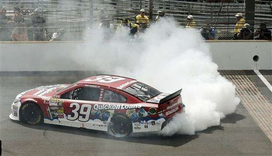 Sprint Cup Series driver Ryan Newman celebrates after winning the Brickyard 400 auto race at the Indianapolis Motor Speedway in Indianapolis, Sunday, July 28, 2013. (AP Photo/Dave Parker) Photo: AP / AP
