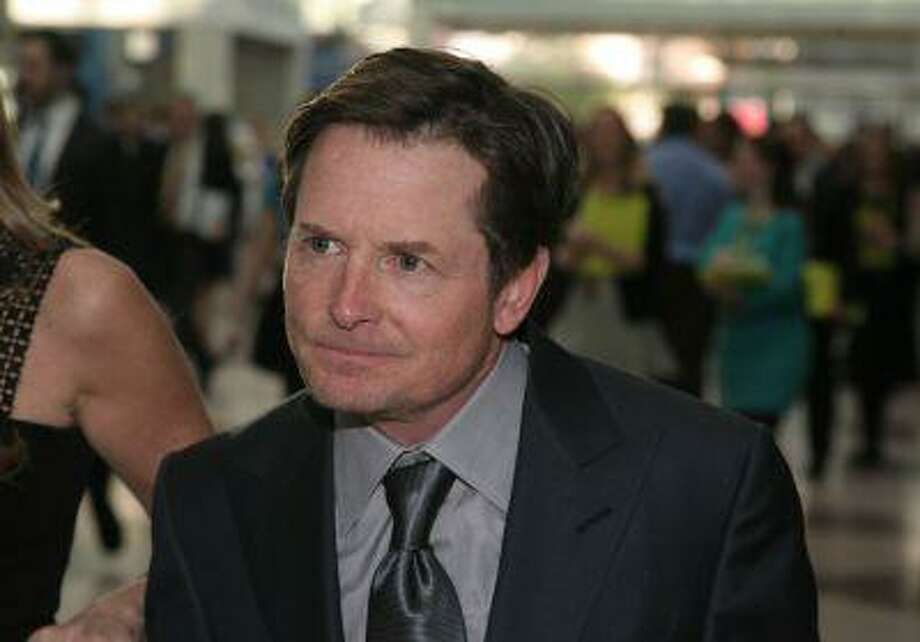 Actor Michael J. Fox attends the Robin Hood Benefit Concert on Monday, May 14, 2013 in New York Photo: Andy Kropa/Invision/AP / Invision