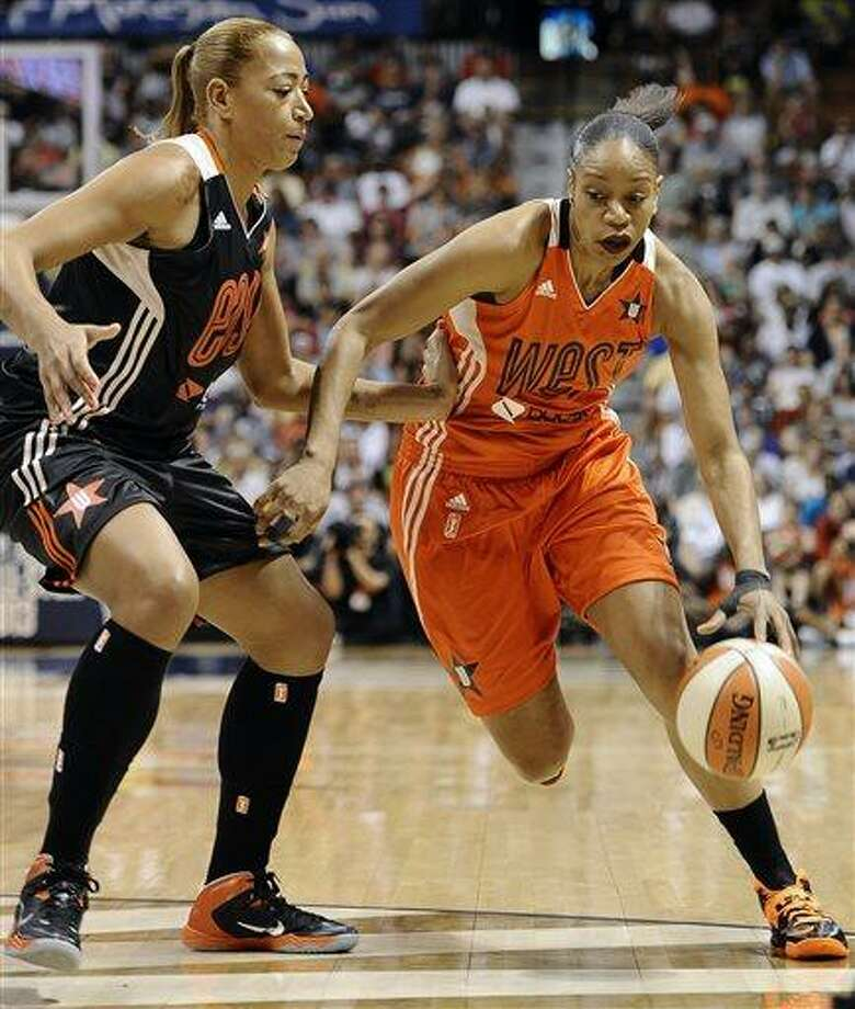 East's Erika de Souza, left, of the Atlanta Dream, guards West's Tina Thompson, of the Seattle Storm, during the first half of the WNBA All-Star basketball game in Uncasville, Conn., Saturday, July 27, 2013. The West won 102-98. (AP Photo/Jessica Hill) Photo: AP / FR125654 AP