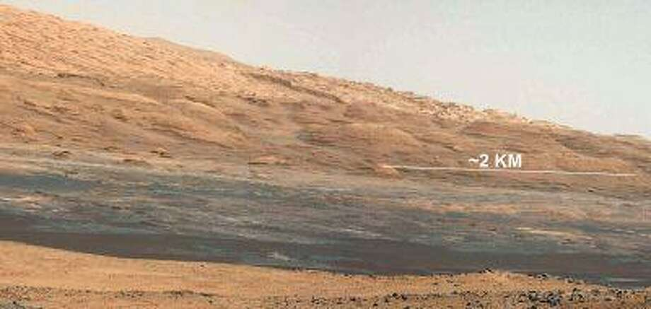 In this photo provided by NASA, a view of the lower reaches of Mount Sharp is shown in a cropped image taken with a 34-millimeter Mast Camera on NASA's Curiosity rover on August 18, 2012 on Mars. Photo: Getty Images / 2012 NASA