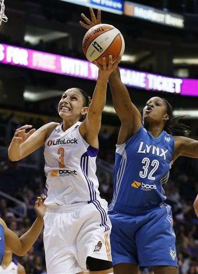 Phoenix Mercury's Diana Taurasi (3) drives past Minnesota Lynx's Rebekkah Brunson (32) during the first half of a WNBA basketball game on Sunday, July 21, 2013, in Phoenix. (AP Photo/Ross D. Franklin) Photo: AP / AP