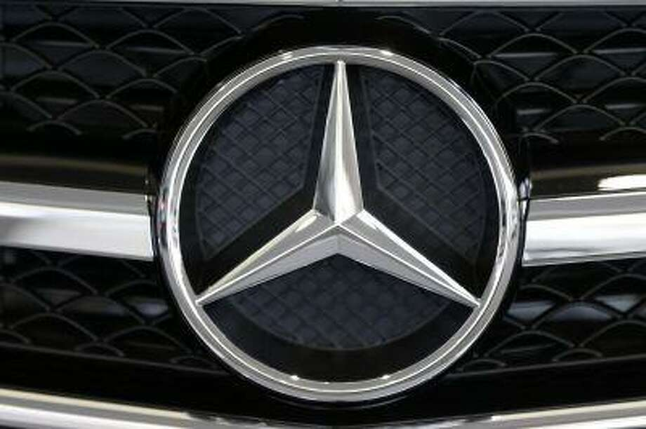 This photo taken on Feb. 14, 2013 shows the Mercedes logo on the grill of a 2013 Mercedes CLS63 AMG Coupe on display at the 2013 Pittsburgh Auto Show in Pittsburgh. (AP Photo/Gene J. Puskar) Photo: AP / AP