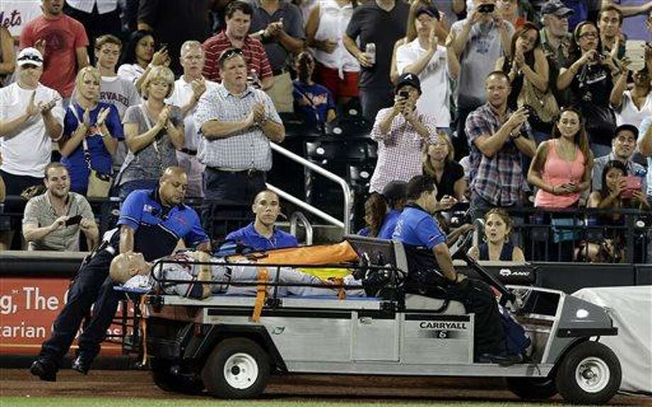 Atlanta Braves' Tim Hudson is carted off the field after being injured during the eighth inning of a baseball game against the New York Mets, Wednesday, July 24, 2013, in New York. (AP Photo/Frank Franklin II) Photo: AP / AP